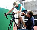 (Click for larger image) AIS biomechanics specialist Brian McLean works with Katie Brown to determine the best crank length to accommodate the restricted range of movement in her left leg. At first, the rider wasn't keen at the thought of using shorter cranks, thinking it was