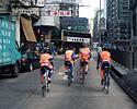 (Click for larger image) Champion System pedals through the streets of Kowloon on Christmas Day.