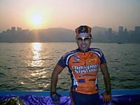 (Click for larger image) Joe Papp with the island of Hong Kong in the background before the start of stage 1 of the Tour of the South China Sea