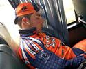(Click for larger image) Joe Papp catches up on sleep en route to the start of a stage.