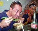 (Click for larger image) Joe Papp and Daniel Lee enjoy a joke during lunch in Macau.