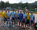 (Click for larger image) The Marco Polo Cycling Team at the Tsunami monument where they left the flowers from winning the stage.