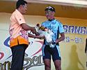 (Click for larger image) Jamsran Ulzii-Orshikh gets flowers for winning stage 5 of the Tour of Siam.
