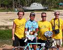 (Click for larger image) Jamsran Ulzii-Orshikh with teammanager Gudo Kramer and sponsors Johan and Dirk from the Marco Polo Cycling Team at the Tsunami monument where Jamsran left his flowers from winning stage 5 in the Tour of Siam 2006.