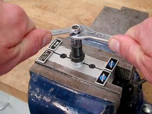 Hold cone while loosening or tightening locknut